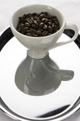 White coffee cup with beans