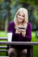 Portrait of Young Woman with Cell Phone