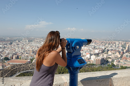 Tourist looking at cityscape