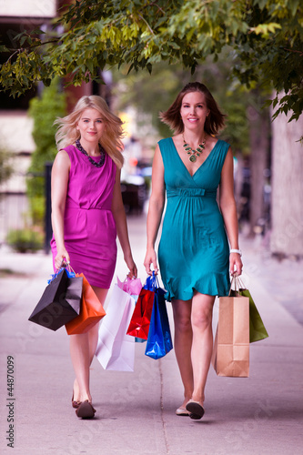 Two Women Walking Down Street