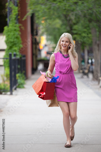 Woman On A Call While Carrying Shopping Bags