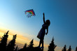Young women flying a rainbow kite