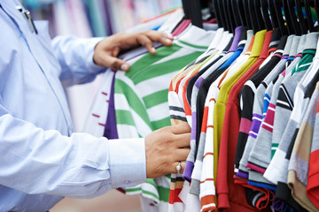Close-up hands choosing clothing