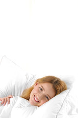 Portrait of young beautiful happy woman on bed