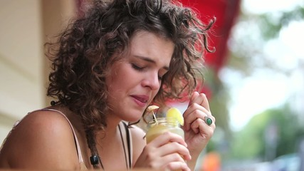 Crying woman with drink