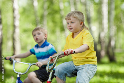 little children riding their bikes