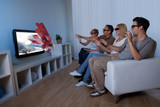 Fototapety Family watching 3D television
