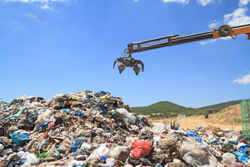 Grabber crane working in landfill