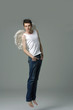 Handsome male angel. Shot in a studio.jumping