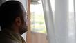 Worried man near window