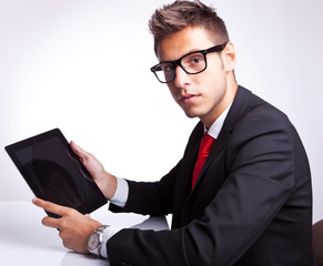 business man holding his tablet pad