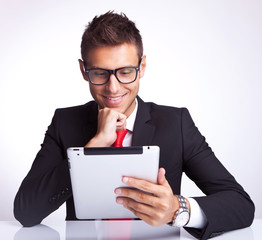man reading interesnting stuff on his pad