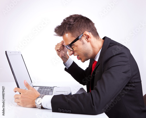 angry business man at his laptop