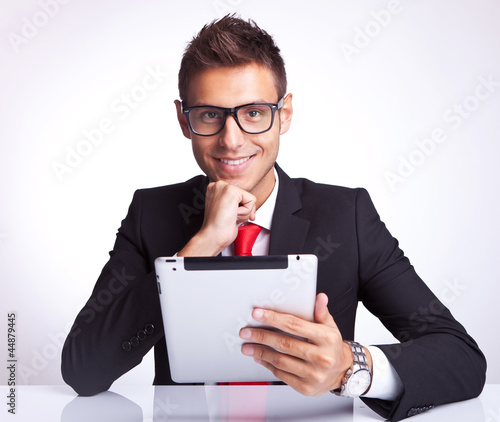 business man smiling with pad in hand
