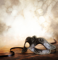 carnival mask with glittering background