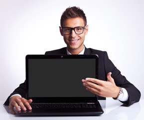 business man presenting new laptop