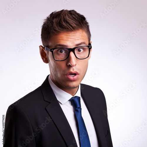astonished young business man or student