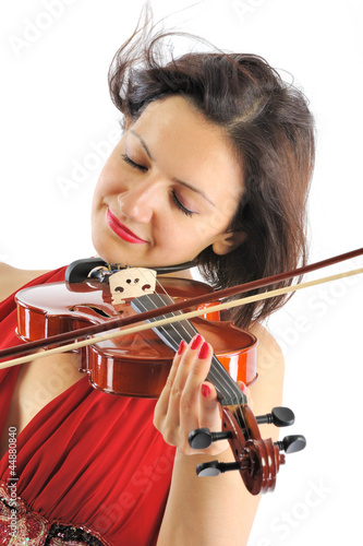 Beutiful musician playing violin isolated on white