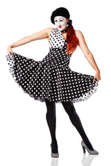 beautiful mime in spotty dress posing