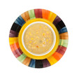 Bowl of corn chowder on colorful dish
