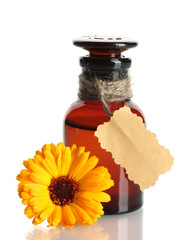 medicine bottle and beautiful calendula flower, isolated