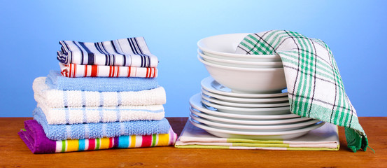 kitchen towels with dishes on blue background close-up