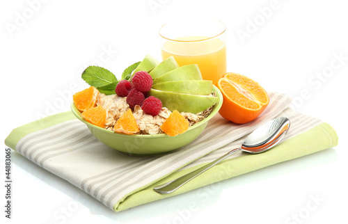 tasty oatmeal with raspberry and fruits, isolated on white
