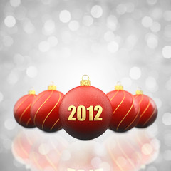 Christmas baubles on white background, 2012