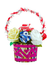 Artificial paper roses in basket isolated on white