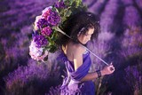 Fototapety beautiful girl in a lavender field under the umbrella of color