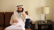 Saudi arabian man drink coffee at home