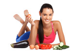 brunette woman posing with healthy vegetables