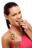 brunette lady eating kiwi