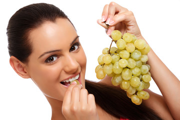 closeup portrait of a brunette teenager with grapes