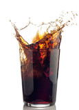 splash of cola with ice cubes
