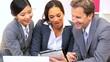 Multi Ethnic Business Team Using Wireless Technology