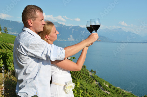 Man and woman tasting wine. Lavaux, Switzerland