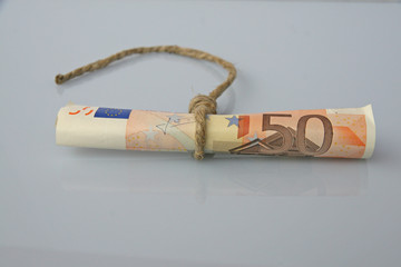 fifty euro banknote in a rope with a noose
