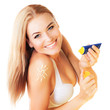 Beautiful woman using sunscreen