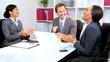 Caucasian Businessman Giving Team Good News