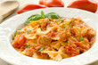 Farfalle topped with tomato sauce, tuna and basil