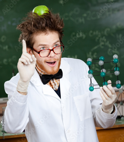 Mad scientist with a green apple on his head