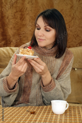 Beautiful Caucasian woman sitting at a table with a cake