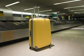 Yellow wheeled suitcase