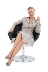 Woman in a suit sitting in a designer swivel chair