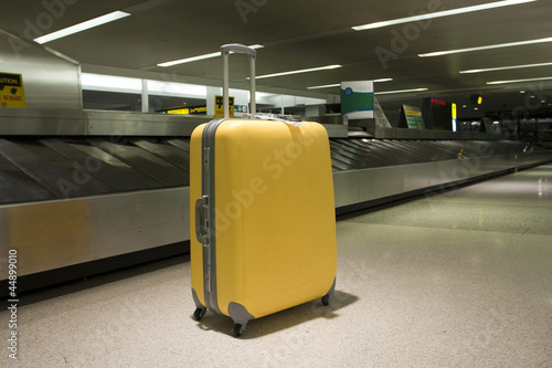 Yellow wheeled suitcase