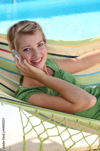 Teen in a hammock with cellphone