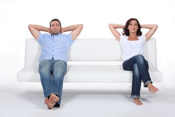 Couple sitting on white sofa