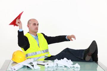 Architect making paper aeroplanes