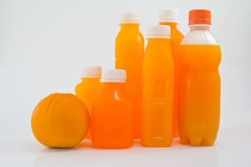 Orange fruit and a bottle with fresh orange juice